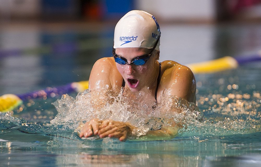 Martha McCabe, former National Team swimmer, swimming her specialty breaststroke.
