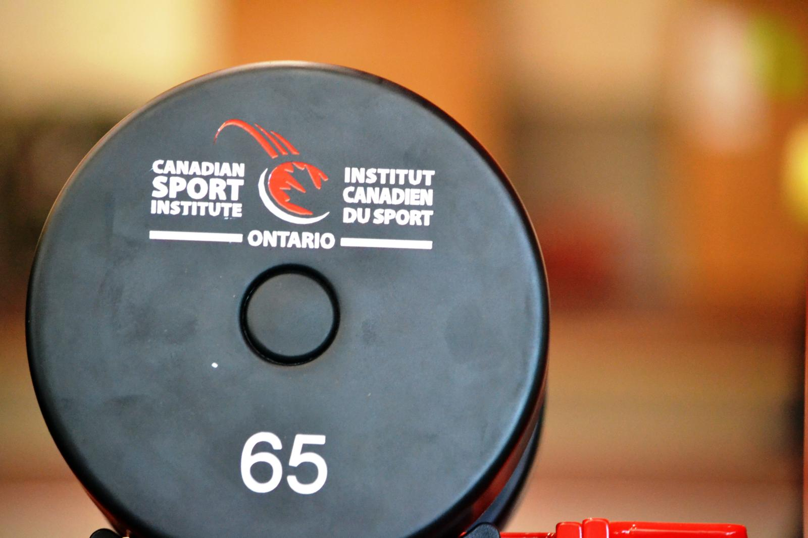 Weight with CSIO logo on it.