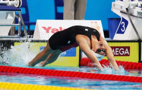 Masse lowers national record on way to 100 back final